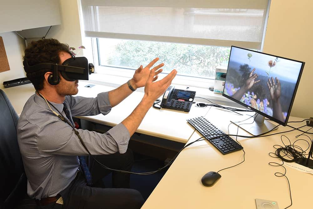 Using virtual reality technology, Nathan King experiences a simulation of vision and hearing loss.