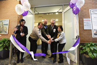 Priya Mendiratta, left, Dirk Reiners, Mark Jansen, Curtis Lowery and Jeanne Wei with a ribbon-cutting celebrate the start of two new educational initiatives at UAMS.