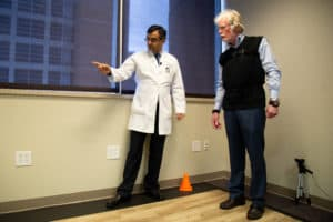 Virmani gives Davis instructions in the gait lab.