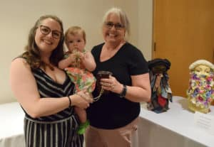 """Kristin Alexander, (left) who created """"She Beards,"""" enjoys the event with her family."""