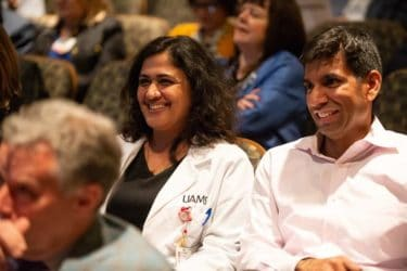 Drs. Singh and Karakala smiling in audience