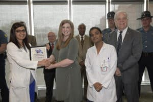 The Arkansas State Police and Lila McWilliams presented plaques to thank the UAMS health care teams.