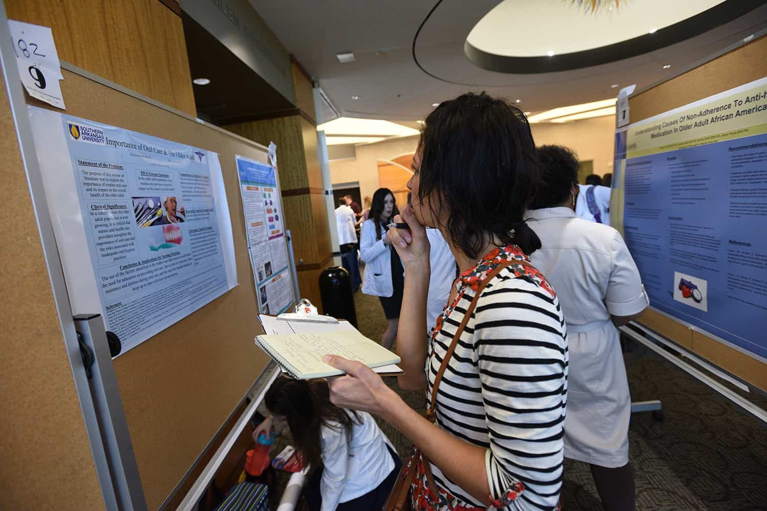 Attendees browse posters at the 2019 Annual Arkansas Nursing Research Conference.