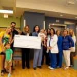 The Haupt Family donates $6,000 to the UAMS NICU Tiny Hands Support Fund.