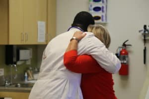 Loweta Bishop hugs her surgeon, Jonathan Laryea, M.D., whenever she sees him.