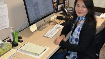 Dr. Liu at desk