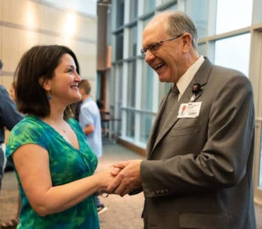 Drs. Westfall and Pulliam shaking hands