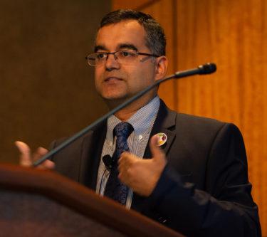 Dr. Vrimani at podium