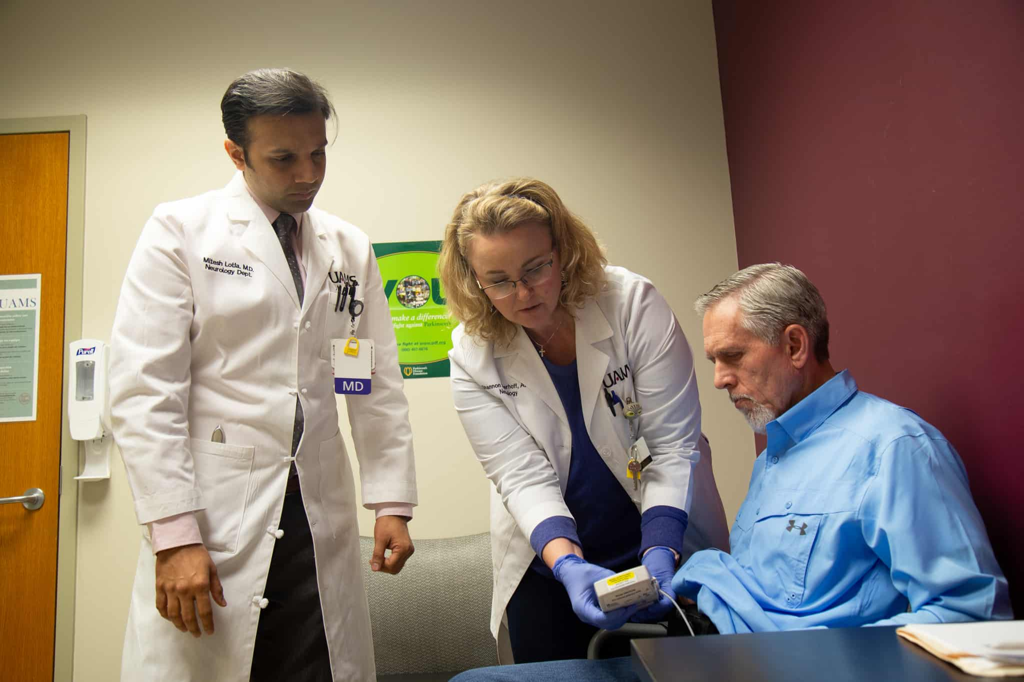 Metish Lotia, M.D. and Shannon Doerhoff, A.P.R.N. go over settings with Mark Avra on his Duopa pump.