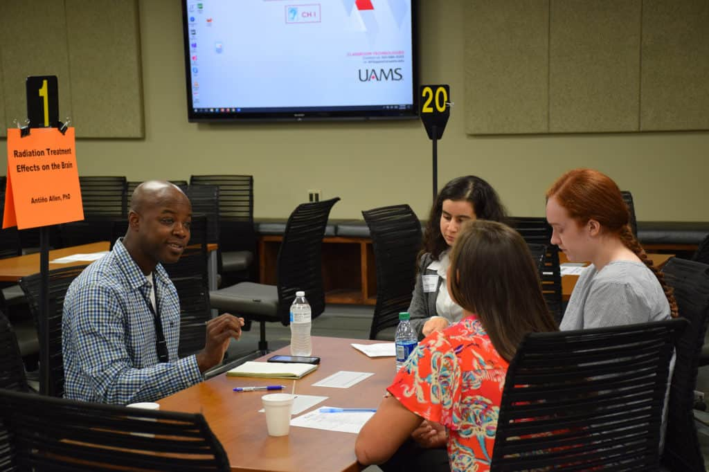 Antino Allen, Ph.D., discusses his radiation therapy research with workshop participants.