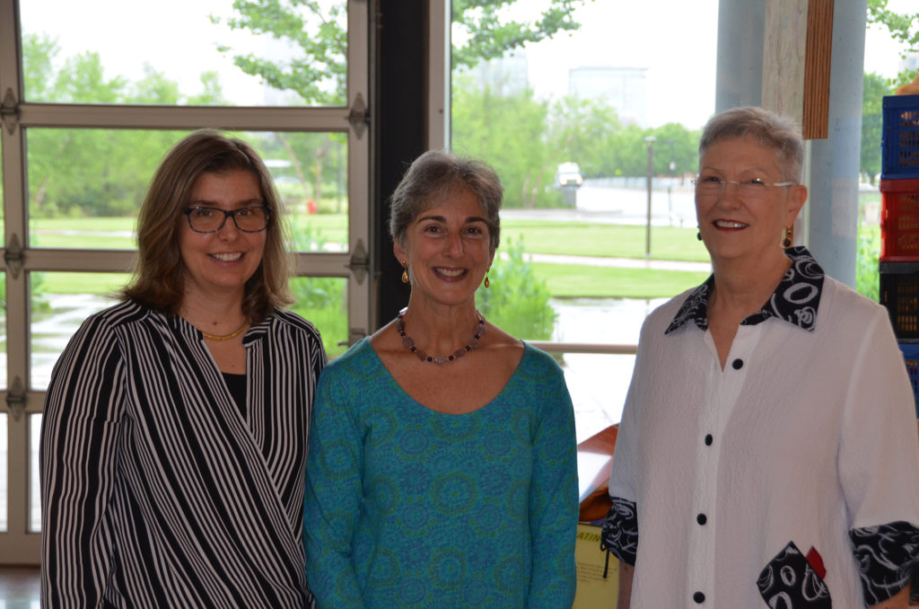 Retreat committee chair Aime Franco, Ph.D. (left) takes a break from the program with keynote speaker Jan Grandis, M.D.,(center) and UAMS Cancer Institute Interim Director Laura Hutchins, M.D.