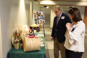 Guests browse a display celebrating Asian and Pacific Islander Heritage Month.