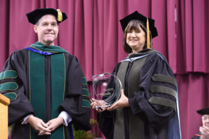 Spollen receives the Award for Teaching Excellence.