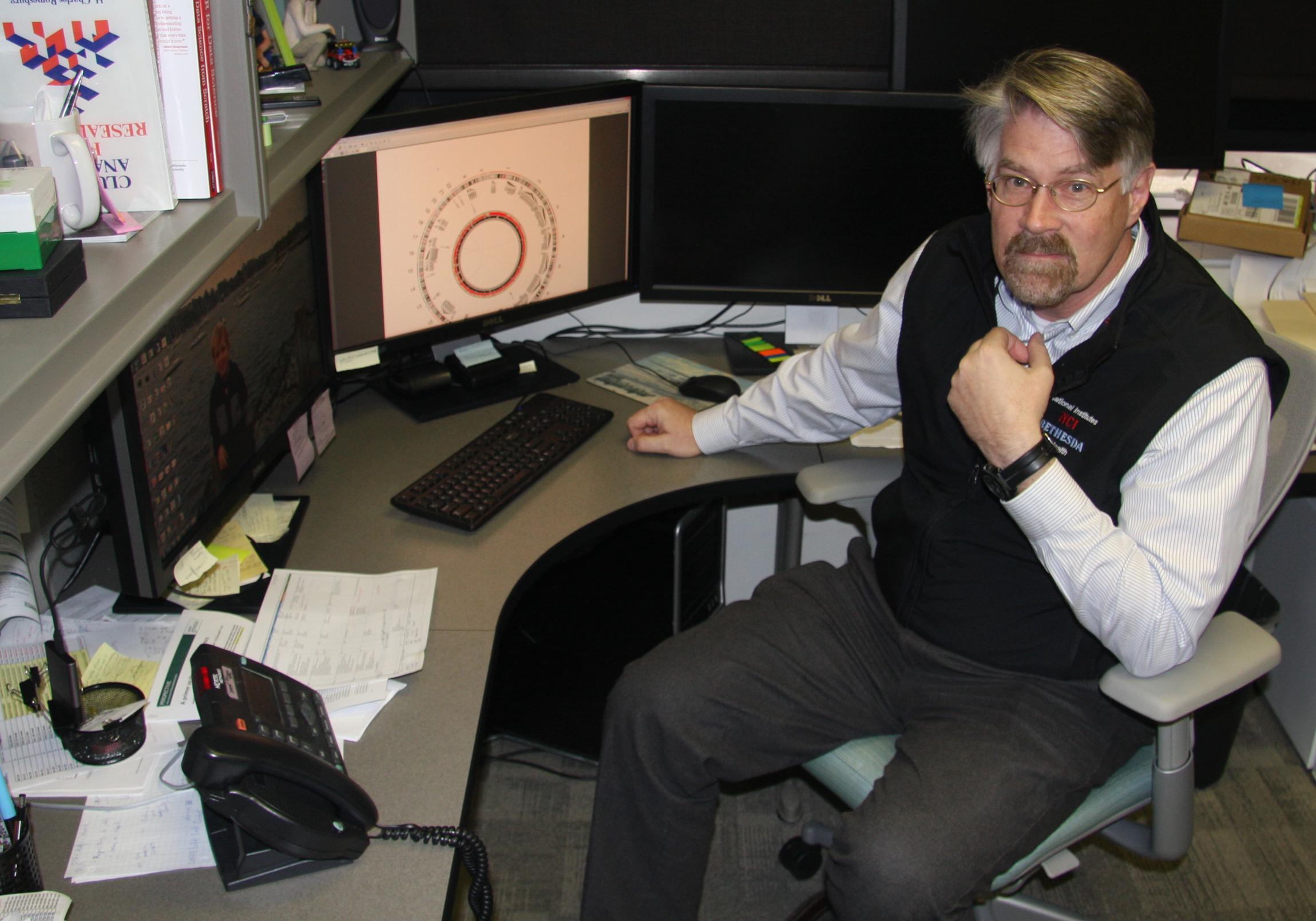 Dr. Johann at desk