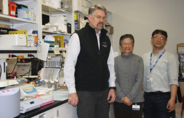 Dr. Johann with group in lab