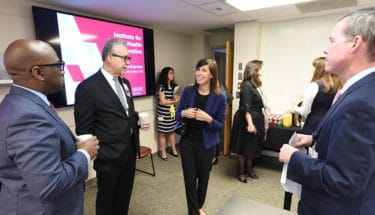 Maurice Rigsby, left, Curtis Lowery, Rosenworcel and Chancellor Cam Patterson talk at the start of the FCC commissioner's recent tour of the UAMS Institute for Digital Health & Innovation.