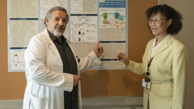 Center for Translational Neuroscience Director Edgar Garcia-Rill, Ph.D., with Vice Chancellor for Research Shuk-Mei Ho, Ph.D.