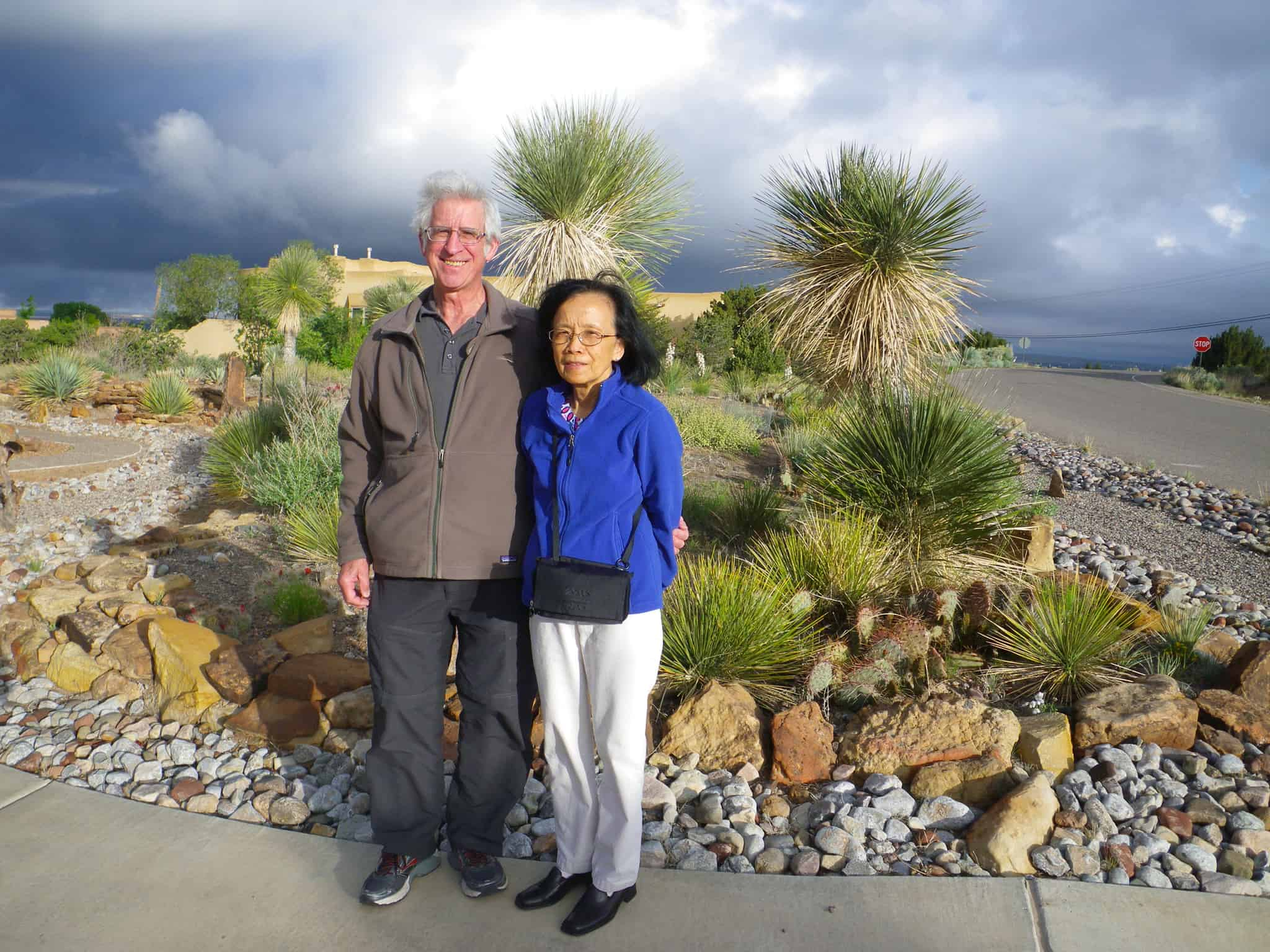 Portrait of Gerry Dienel and Nancy Cruz outside, surrounded by desert plants