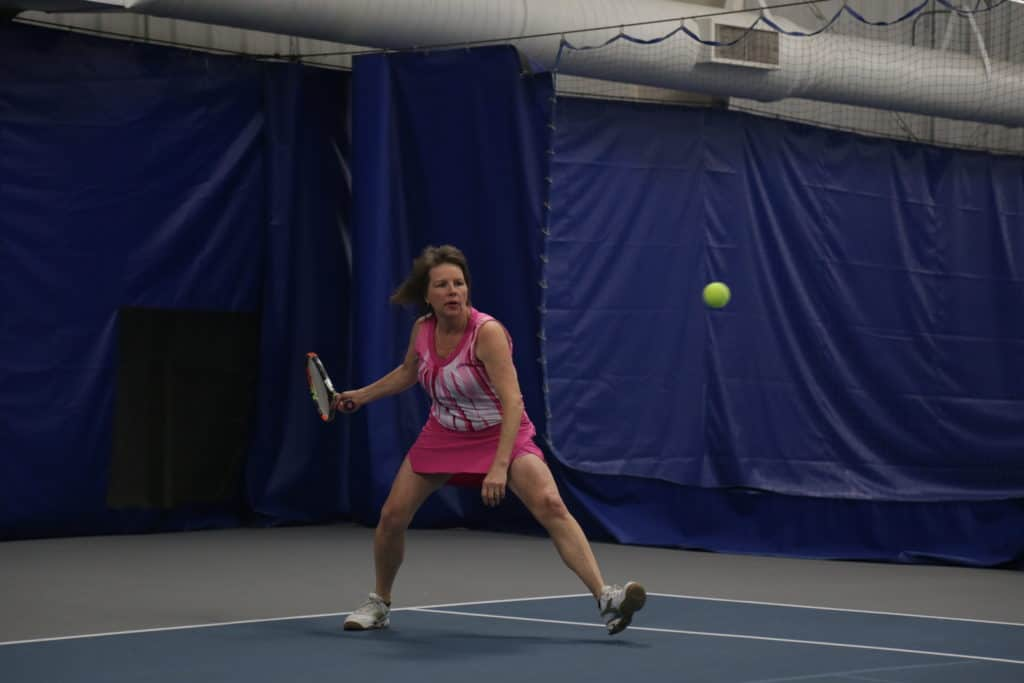 Michele Perry plays tennis at the Little Rock Athletic Club.