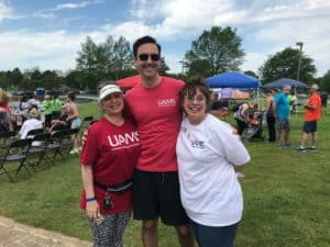 Conan Mustain, M.D., a colon and rectal surgeon, and UAMS wound, ostomy and continence nurses Brenda Goss, R.N., and Lori Phares, R.N., at the Take Steps for Crohn's and Colitis Walk on April 27.