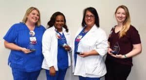 From left: Michele Hudnall, Gwen Price, D'Anna Williams and Jessie Daniel, winners of the Center for Nursing Excellence Annual Nursing Recognition Awards.
