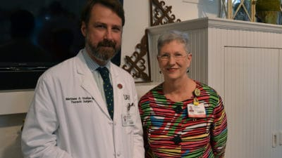 Matthew Steliga, M.D., (left) is joined by UAMS Cancer Institute Interim Director Laura Hutchins, M.D., following his introduction as the UAMS Cancer Institute Auxiliary Distinguished Honoree.