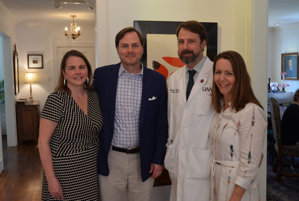 Peyton and Bill Woodyard (left to right) hosted the luncheon honoring Matthew Steliga, M.D., who is pictured with his wife, Kelly.