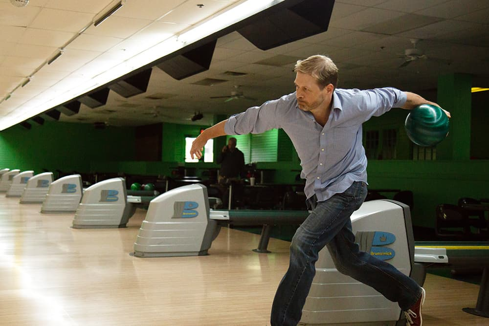 After treatment at UAMS for a stroke, Timothy Raines found bowling helped him recover from its effects.