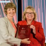 Jean McSweeney, Ph.D., RN, (left) receives the Volunteer of the Year Award at the American Heart Association ceremony in Dallas June 19, 2019.
