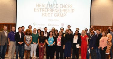 The entire class of the 2019 Health Science Entrepreneurship Boot Camp and some of the students' instructors and mentors take a moment for one last photo before the end of the weeklong class.