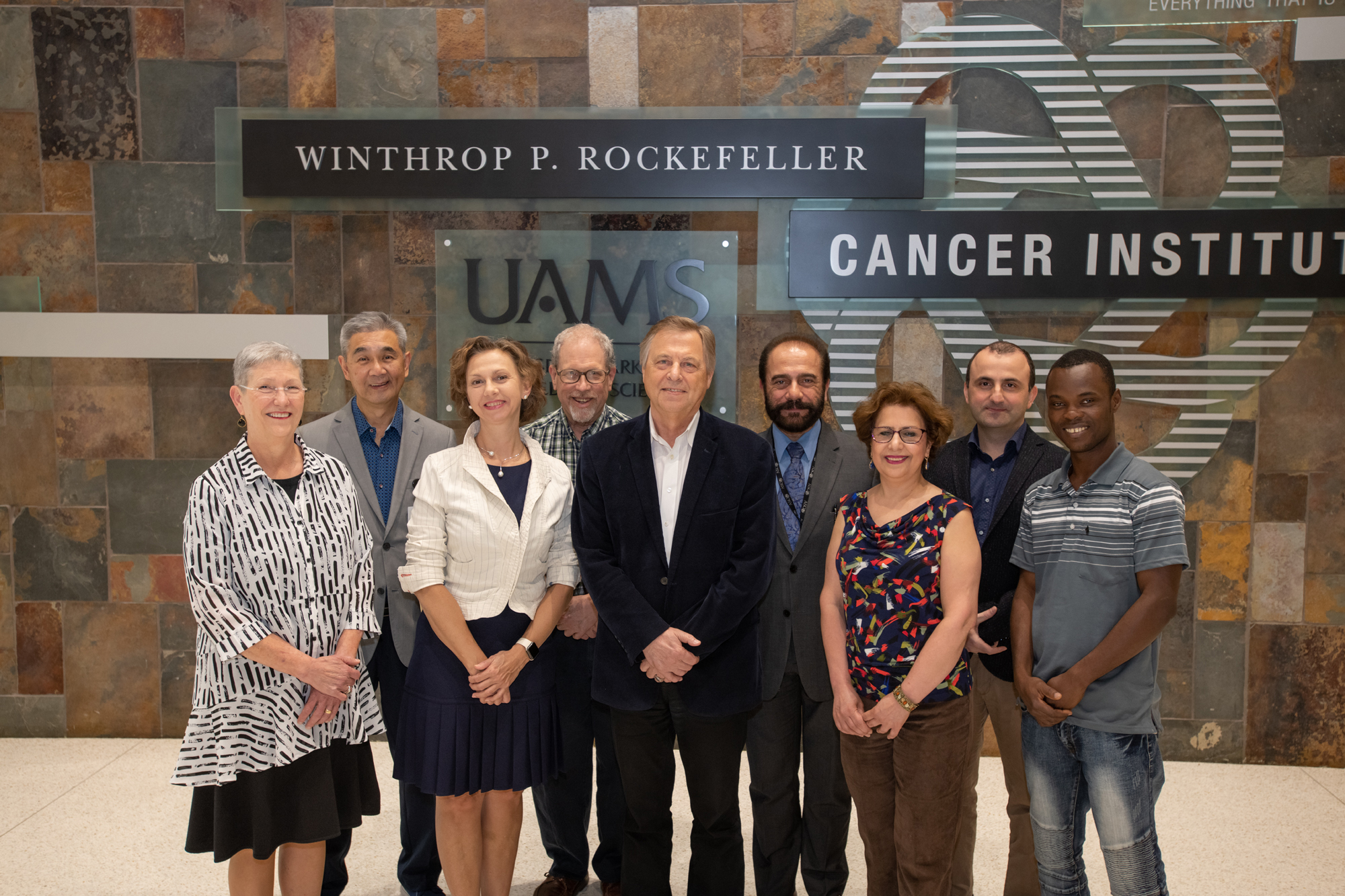Vladimir Zharov, Ph.D., Ds.C. (center) is pictured with collaborators (left to right) Laura Hutchins, M.D.; James Y. Suen, M.D.; Ekaterina I. Galanzha, M.D., Ph.D., D.Sc.; Eric Siegel, M.S.; Issam Makhoul, M.D.; Azemat Jamshidi-Parsian, M.S.; Mustafa Sarimollaoglu, Ph.D; and Aayire C. Yadem, M.S.