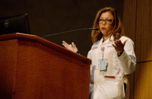 "Gloria Richard-Davis, M.D., told students that the white coat is a ""symbol of professionalism, caring, compassion, candor and trust, which you must earn from your patients."""
