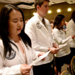 Students from the Physician Assistant Studies Class of 2021 recite the Physician Assistant Professional Oath during a May 24 white coat ceremony.