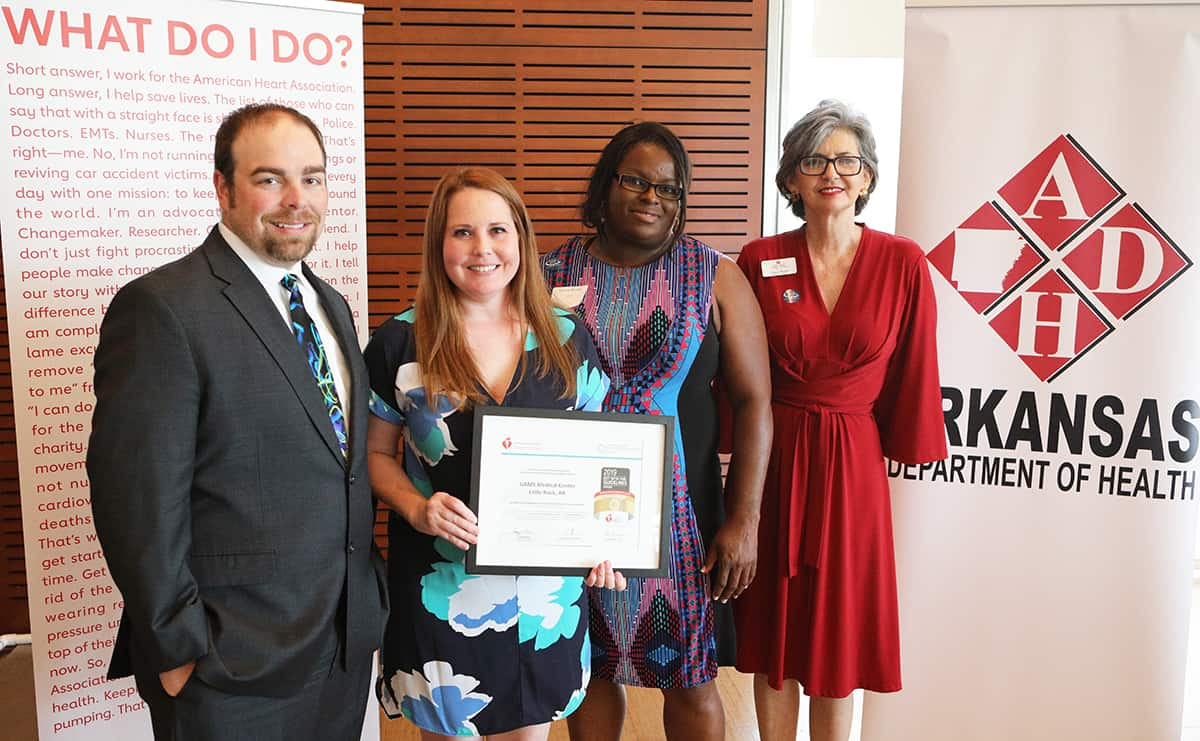 Matt Mitchell, left, Deonna Wissler and Patrice Moody accept the Get With The Guidelines Award from Joyce Taylor, far right.