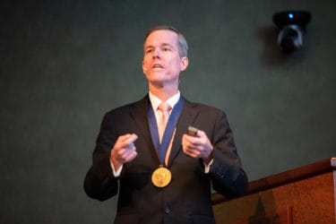 Patterson, wearing his medallion, spoke about the importance of connections.