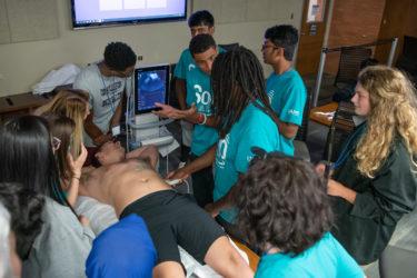 Students ultrasounding a stomach
