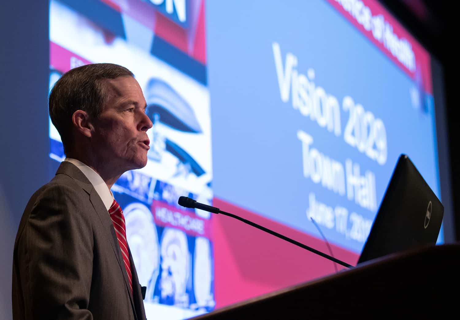 UAMS Chancellor Cam Patterson, M.D., MBA, speaks to a university town hall audience about the Vision 2029 strategic plan.
