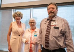 Darla and Robert Lavender, M.D., pose with Edwina Mann, (center) the Inaugural recipient of the Patricia Lavender Distinguished Service Award. The award was named in honor of Dr. Lavender's mother, a long-time volunteer at UAMS and with the Arkansas Hospital Association.