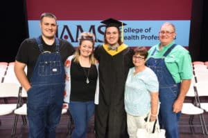 Danny McNeely (center) earned a Master of Science in Communication Sciences and Disorders. McNeely said the support of his family and friends was essential to his success at UAMS.