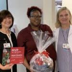 Stephanie Gardner, Pharm.D., Ed.D., presents Gayla Houston with a UAMS swag basket.