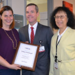Dr. Weinkopff posing with plaque and Drs. Patterson and Ho