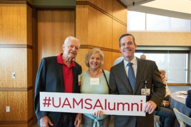 Charles Cale, M.D., COM '64, his wife Sherlyn, and UAMS Chancellor Cam Patterson at the Friday night reception.