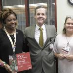 Chancellor Cam Patterson, M.D., MBA and Amber Daugherty, information technology manager, congratulate Zina Kidd (left) on being the UAMS MVP of the Month. Kidd works in the Appointment Business Center.
