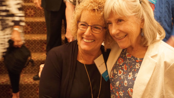 Judy Huneycutt and Jill Lancaster, both CON '69, pose for photos during the Saturday night Golden Grad dinner at the Capital Hotel.