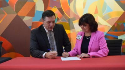Dr. Randy Esters, North Arkansas College president, and Stephanie Gardner, Pharm.D., Ed.D., UAMS provost, sign an agreement Monday in to allow Northark Medical Laboratory Technology (MLT) graduates to transfer to an online program at UAMS to earn a Bachelor of Science degree in Medical Laboratory Sciences (MLS).