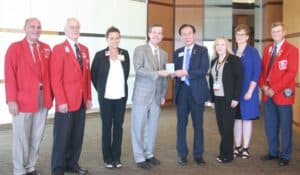 Members of the Lions Club of Arkansas and Choi thanked Patterson after being welcomed to UAMS.