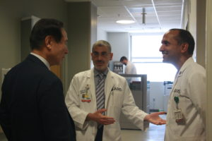 Sami Uwaydat leads Choi on a tour of his clinic at the Jones Eye Institute and introduces him to other physicians.