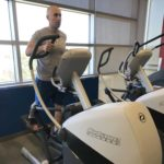 Adam Carter, manager of the UAMS Fitness Center, works out on an XT-One machine, one of six new pieces of equipment in the Fitness Center.