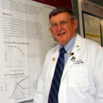 Portrait of Dr. Culp near research poster