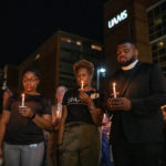 UAMS faculty, staff and students hold lighted candles in memory of Edith Irby Jones, M.D., who died July 15.